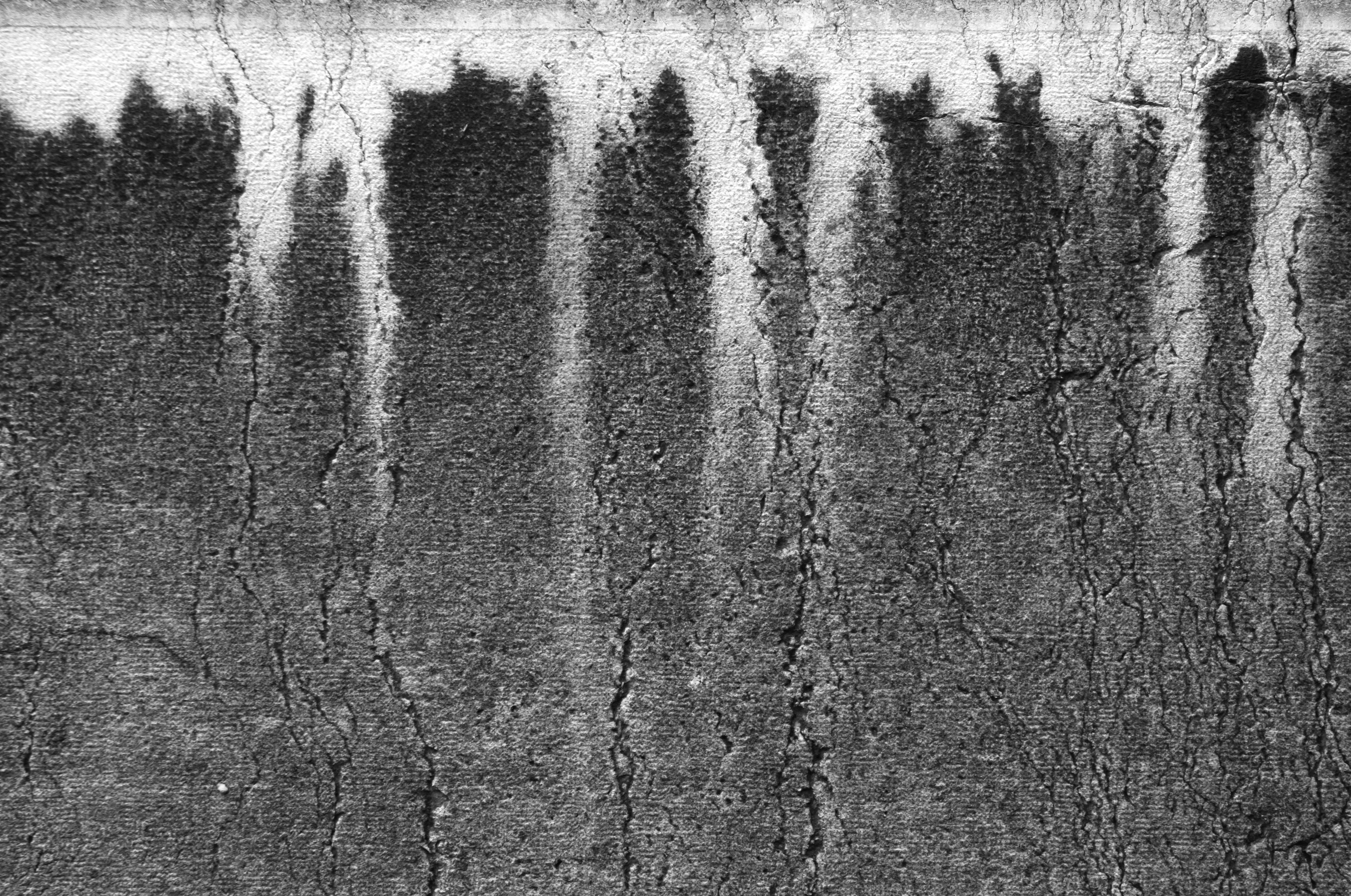 taches de pollution sur un mur, effet de coulures blanches